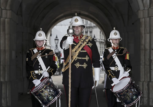 Close of up of three Members of Massed Bands of HM Royal Marines Beating Retreat including Royal Marines Corps of Drums