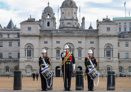Members of Massed Bands of HM Royal Marines Beating Retreat outside Horse Guards Parade with Drum Major