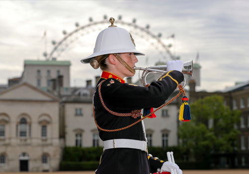 A bugler of Massed Band of HM Royal Marines Beating Retreat